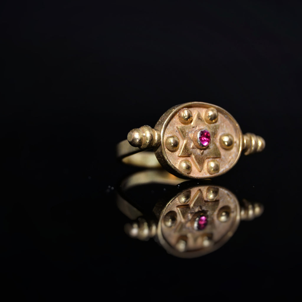 Ruby Gold Turning Ring