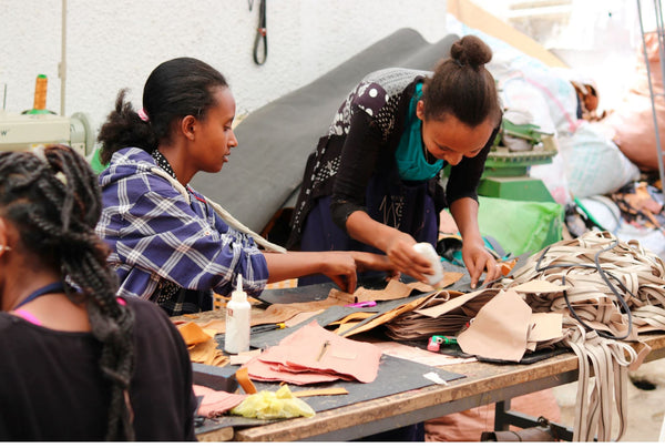 Sabegn artisans working on leather goods