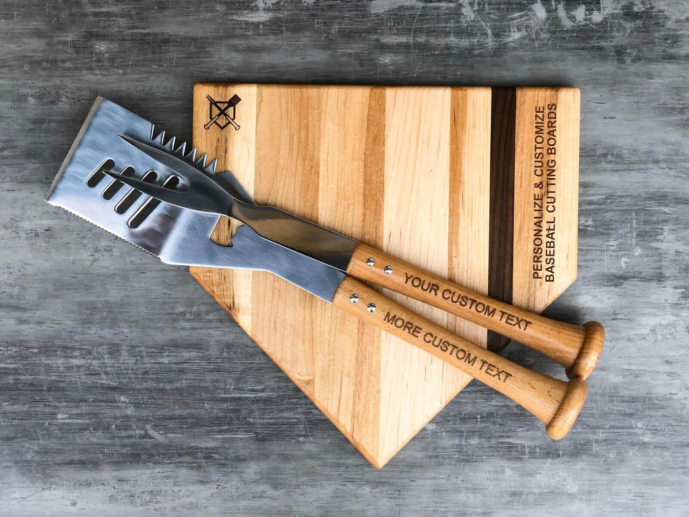 Personalized BBQ grill tools with wood baseball bat hats. Customized Baseball BBQ tools make the perfect gift for baseball and BBQ fans for Father's Day, birthdays, housewarmings.