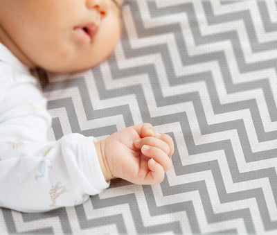 Baby on Bassinet Sheet | Chevron Grey