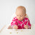 Baby in Cleanbib With Sleeves | Fuchsia Modern Flowers