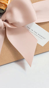 Close up photograph of a gift tag on a gift box