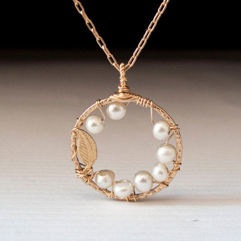 Minimalist Circle Pendant with Pearls and Feather by Lior Zager