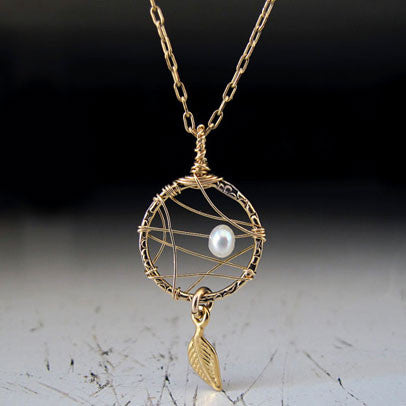 Minimalist Circle Pendant with Pearl and Feather by Lior Zager