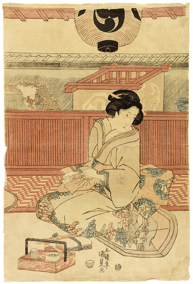 Beauty Wrapping a Package by Kunisada Utagawa as Toyokuni III - Davidson Galleries