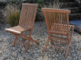 pair of teak classic folding chairs close up