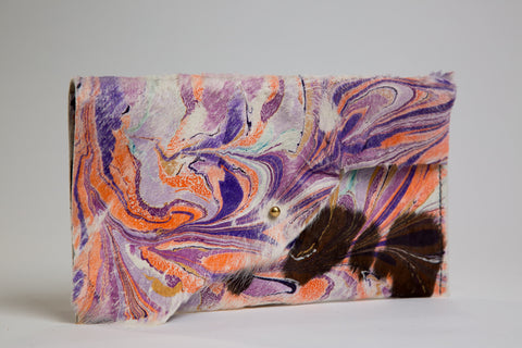 Purple and Orange Hair on Hide Clutch