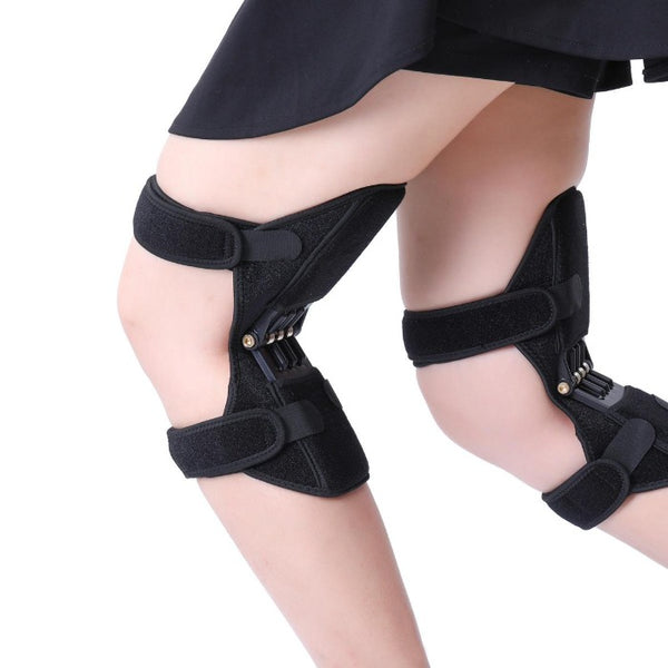 Image of Knee Brace Supports With Spring Hinges. Shows braces from the side of the person whose legs are bent showing the flexing of the Knee Brace Supports with Spring Hinges.