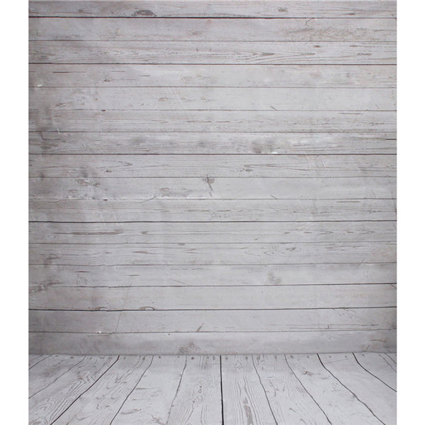 This is a closeup photo of the 5 x 7 foot photo backdrop showing light grey weathered boards. The portion of the backdrop that is in on the floor shows boards running in the same direction as the viewer. The boards on the vertical portion of the backdrop are 90 degrees to the floor boards.