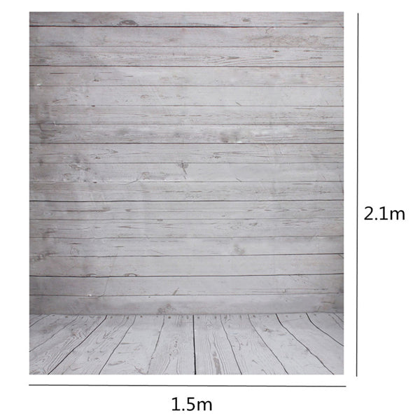 Photo of the photo backdrop showing grey weathered boards. The portion of the backdrop that is in on the floor shows boards running in the same direction as the viewer. The boards on the vertical portion of the backdrop are 90 degrees to the floor boards. There is also a measurement showing 2.1 meters tall (7 feet) by 1.5 meters wide (5 feet).