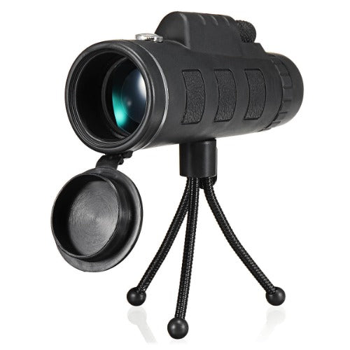 Monocular lens on tripod with lens protective cover open