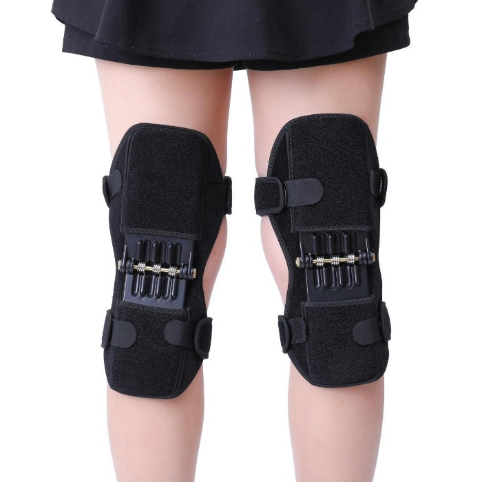 Image of Knee Brace Supports With Spring Hinges. Shows braces from the back of the person.