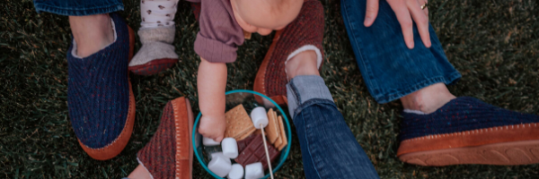 Family enjoying marshmallows in acorn slippers