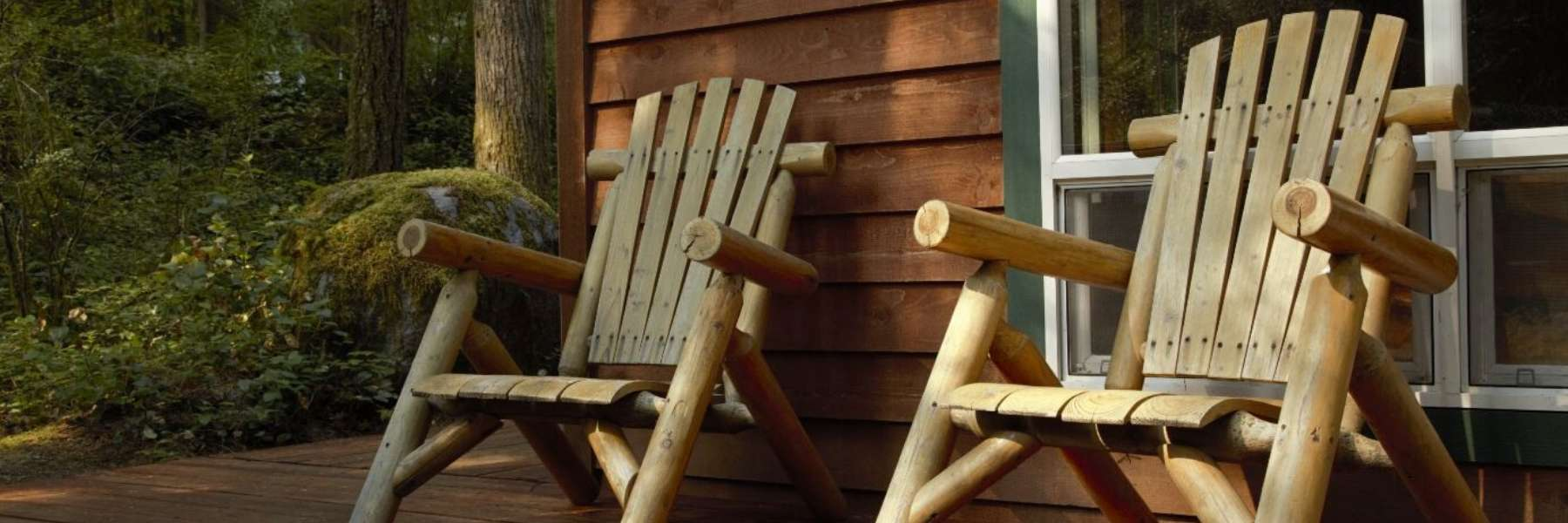 Chairs on the porch of a cabin in the woods