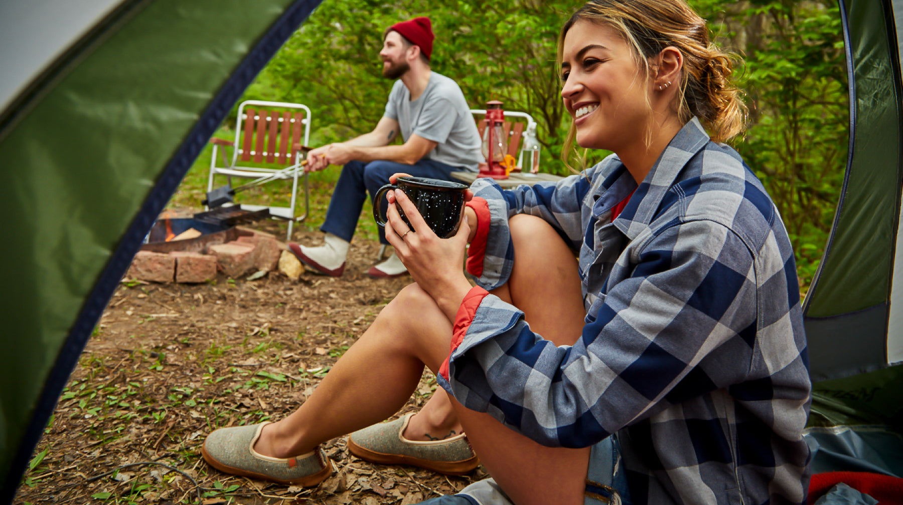Friends camping in the woods wearing new Acorn outdoor slipper styles
