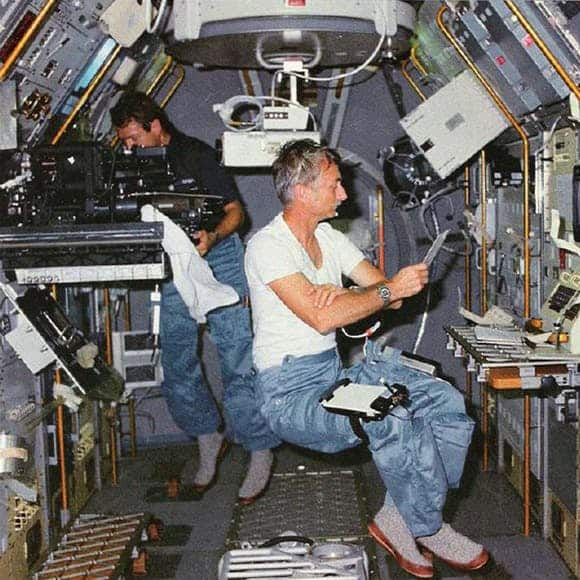 Two Male Astronauts Wearing Slipper Socks on the Space Shuttle