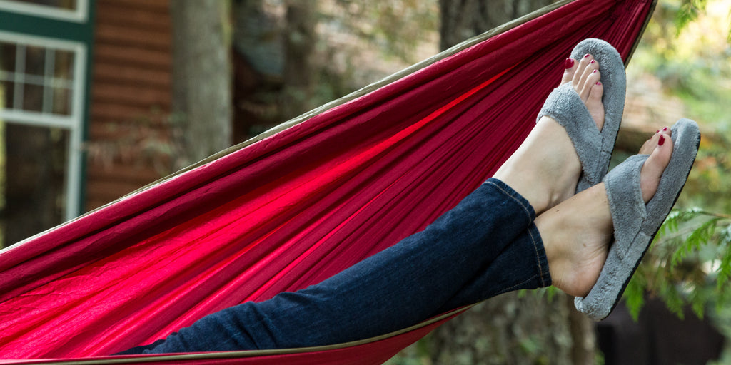 Woman lounging in a hammock wearing spa thong slippers