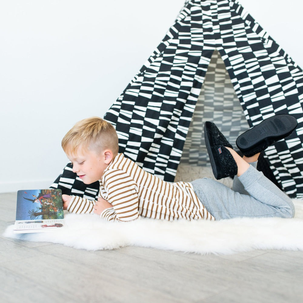 Kid's Colby Gore Moccasins in Black Berber On Model Reading on the Floor