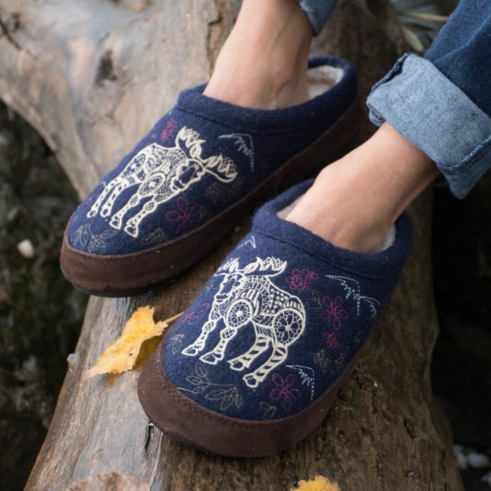 Women's Forest Mule Slippers in Navy Moose On Model Sitting on Log