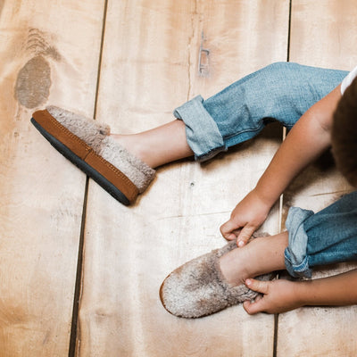 Kid's Original Acorn Moccasins in Brown Berber on Model on Wood Flooring