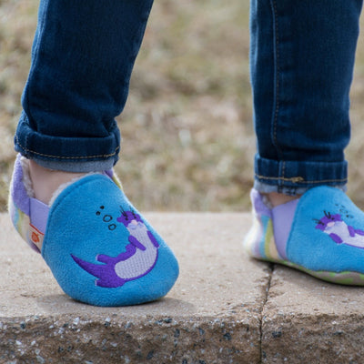 Toddler's Easy-On Animal Slippers in Ocean Blue Otter On Model on Stone