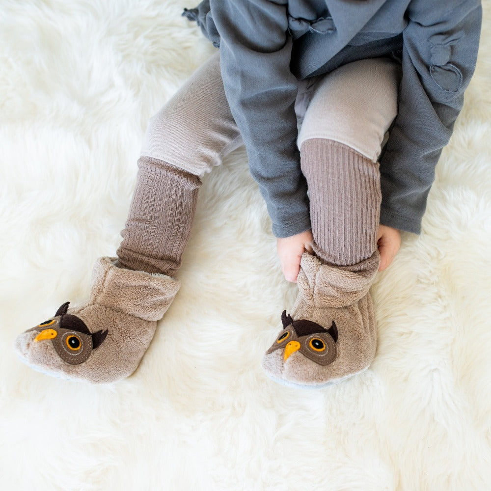 Toddler's Critter Booties in Owl on Model on Sheepskin Rug