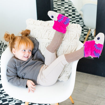 Toddler's Critter Booties in Very Berry Hedgehog On Model Sitting in Chair With Her Legs Up