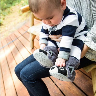 Toddler's Critter Booties in Raccoon On Model Sitting on Parent's Lap