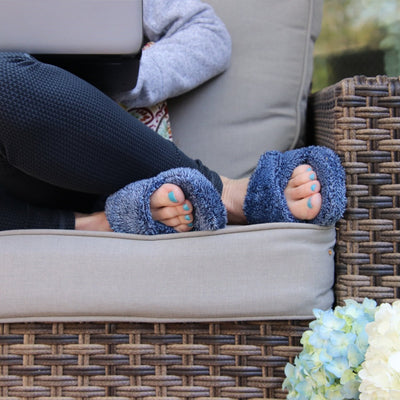 Women's Spa Slide Slippers in Navy Heather on model sitting on backyard furniture working on a laptop