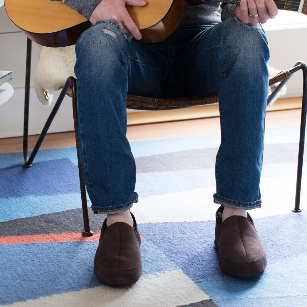 Men's Wool-Lined Romeo Slippers on figure sitting inside playing guitar