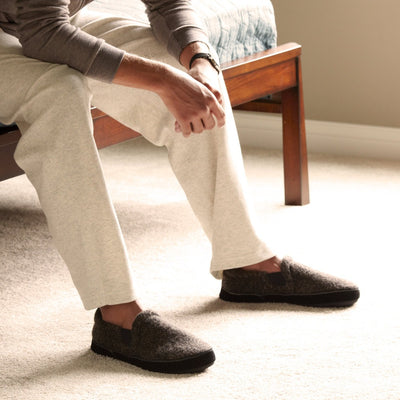 Men's Italian Wool Gore Moccasins on figure sitting on edge of bed indoors