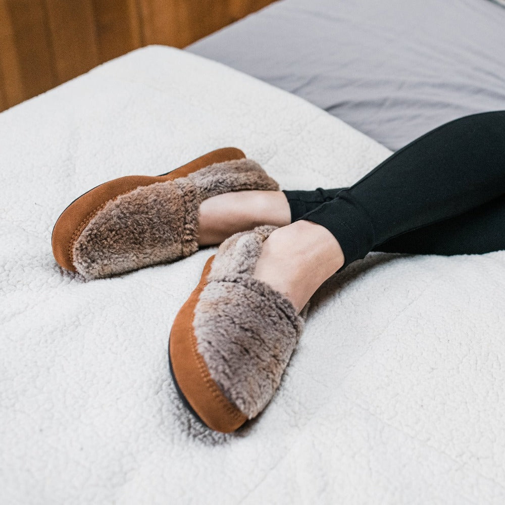 Women's Original Acorn Moccasins iin Brown Berber on Model in Bed