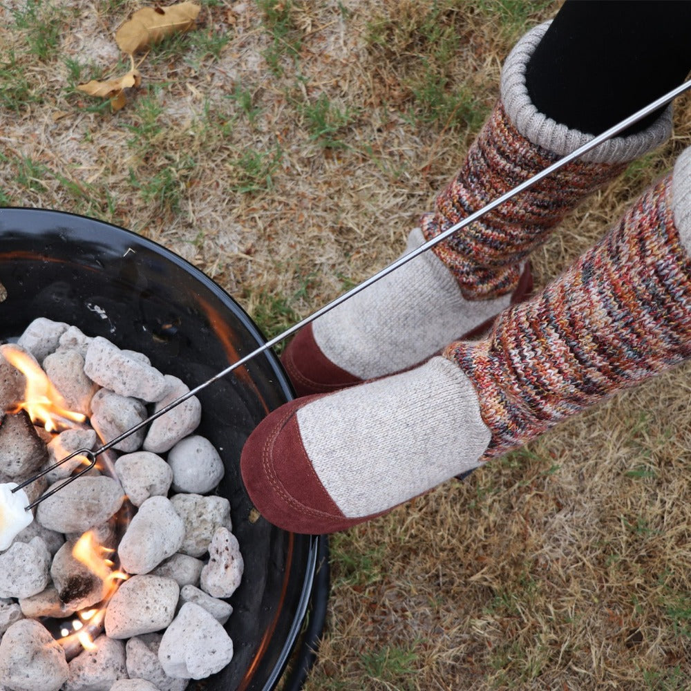 Women's Slouch Boots in Sunset Cable Knit On Model Roasting Marshmallows Over a Fire