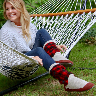 Women's Slouch Boots in Classic Buffalo Plaid On Model Sitting in a Hammock
