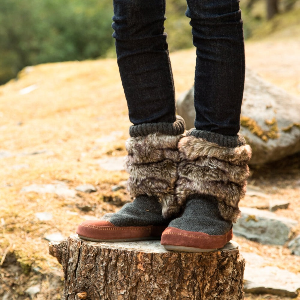 Women's Slouch Boots in Charcoal Faux Fur On Model Standing on Tree Stump