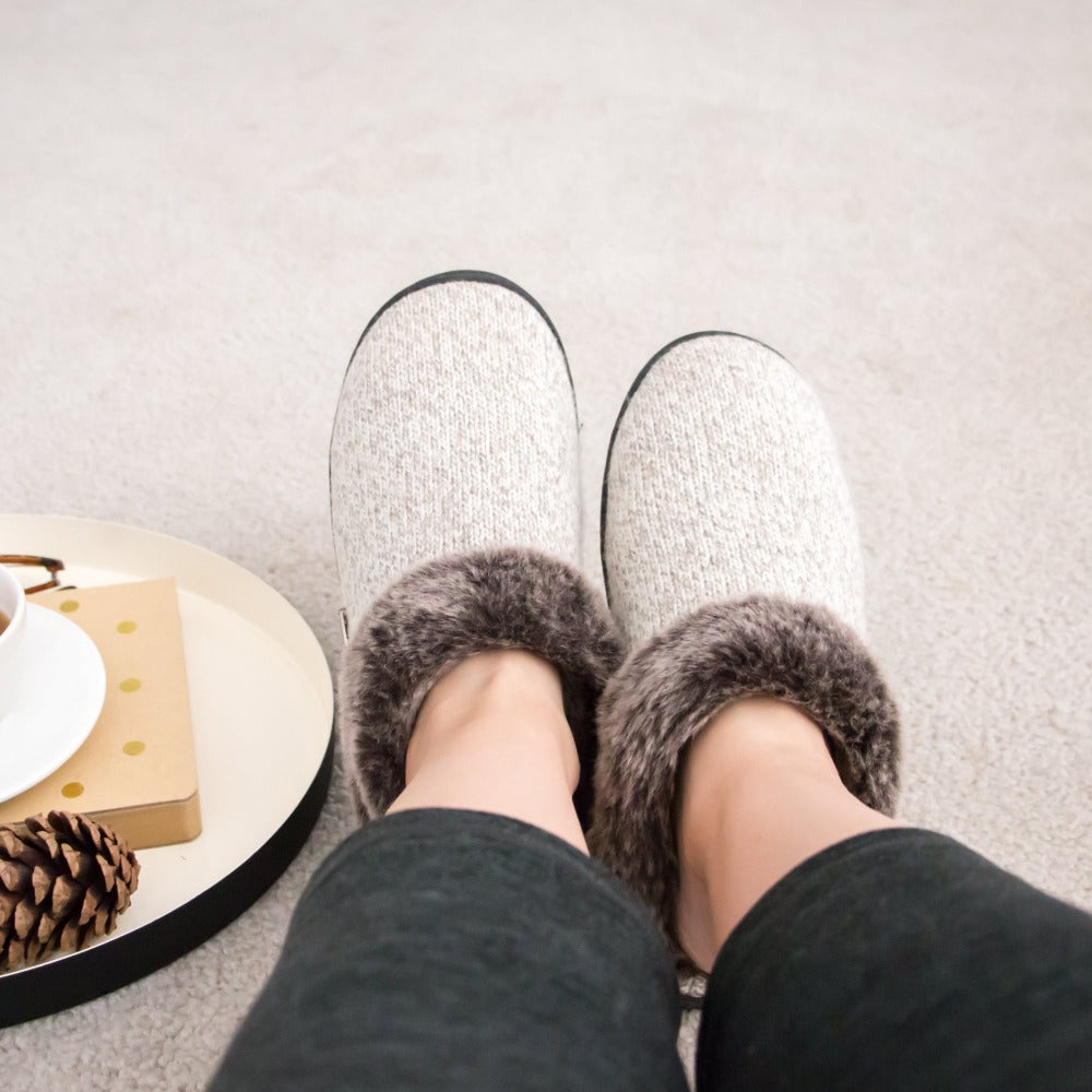 Women's Faux Fur Chinchilla Ragg Slippers on figure sitting on floor with coffee