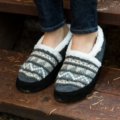 Women's Nordic Moccasins on figure standing on wooden steps outside
