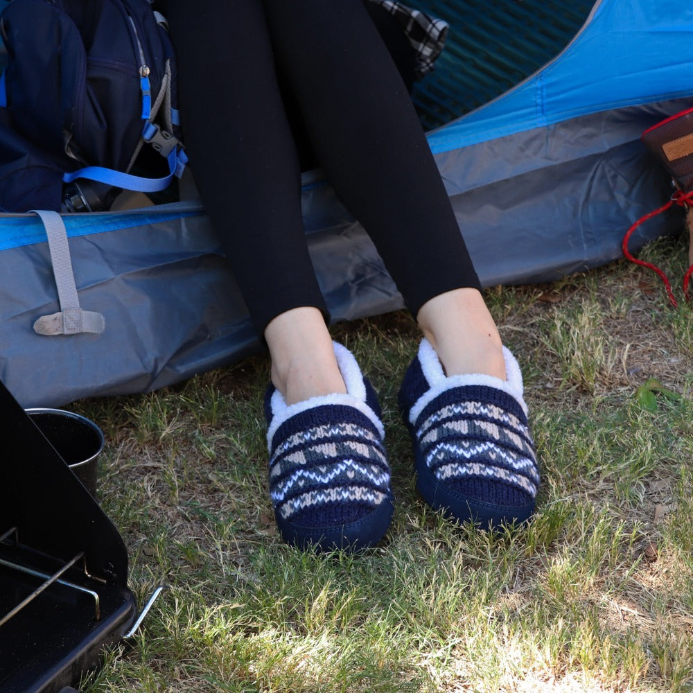 Women's Nordic Moccasins on figure sitting outside of tent