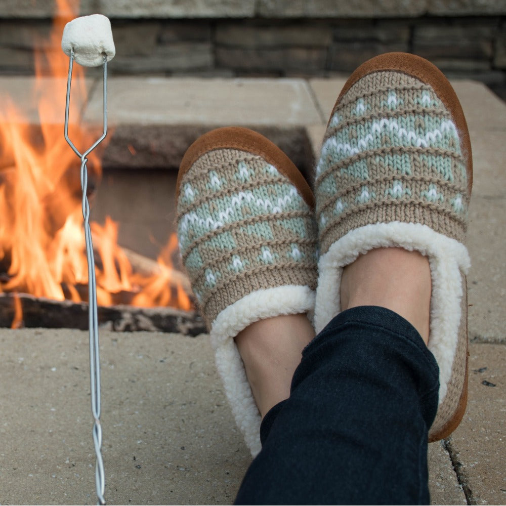 Women's Nordic Moccasins on figure sitting by fire with feet up roasting marshmellows