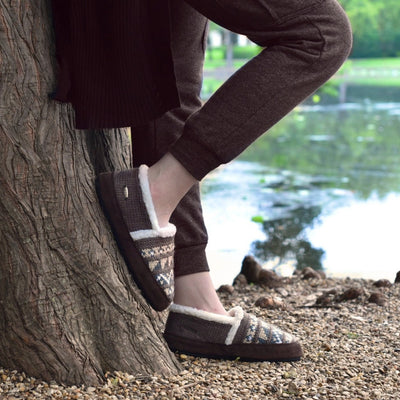 Women's Nordic Moccasins on figure standing against a tree outside by lake