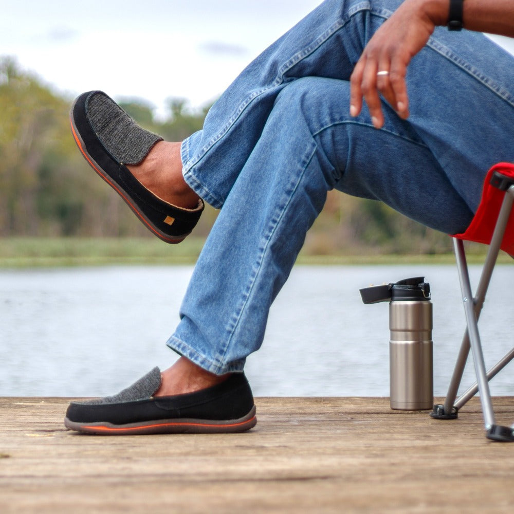 Men's Ellsworth Mocassins on figure sitting on mossy rock in woods