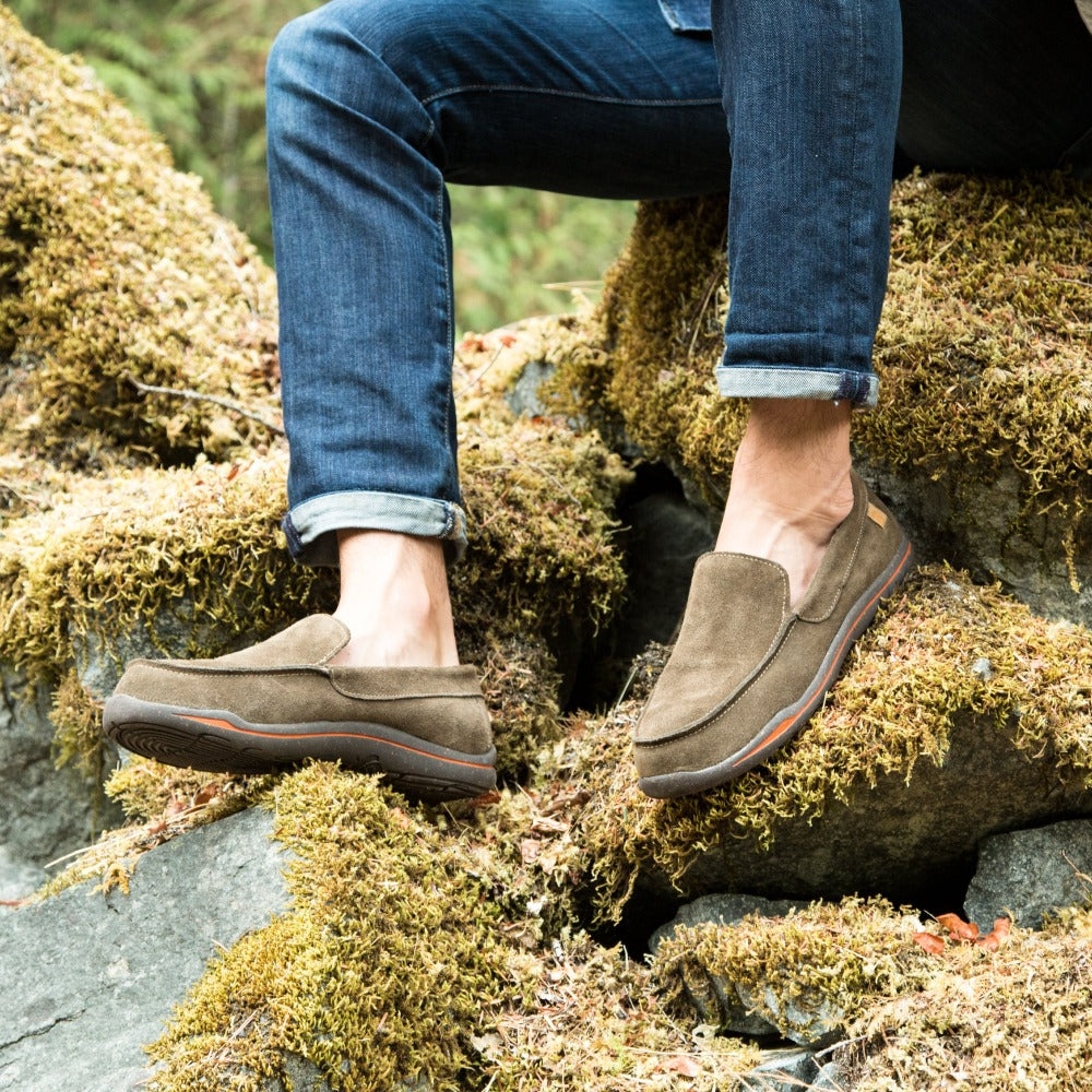 Men's Ellsworth Moccasins on figure sitting on mossy rock in woods