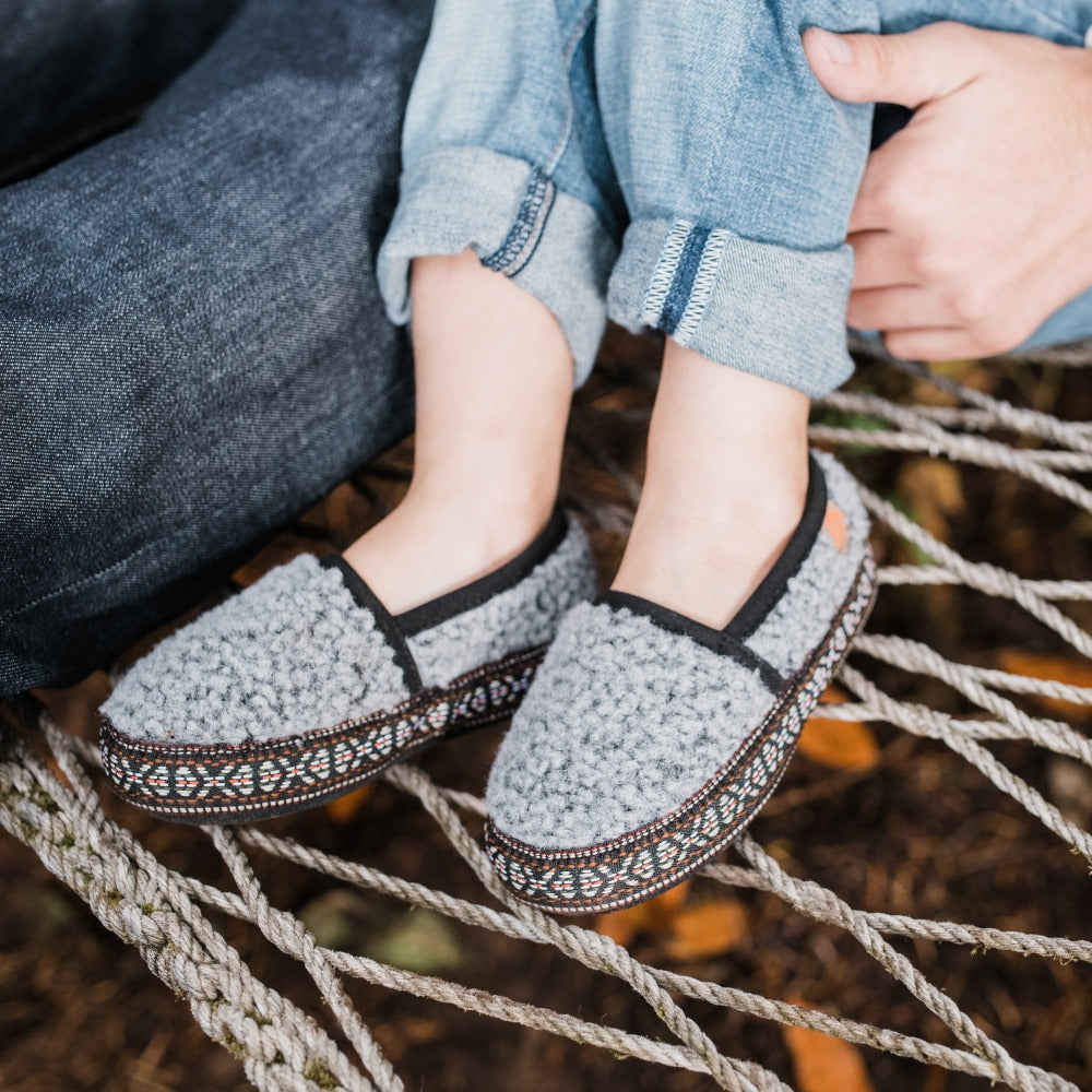 Kid's L'il Woven Trim Moccasins on figure laying in hammock outside