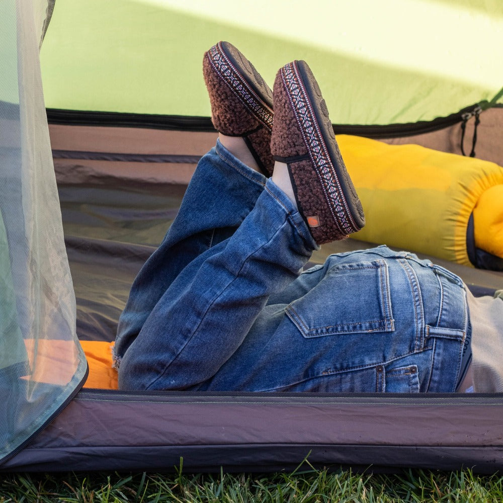Kid's L'il Woven Trim Moccasins on figure laying outside in tent kicking feet up
