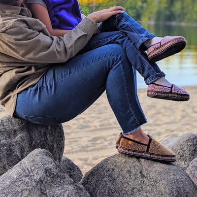 Women's Woven Trim Moccasins on figure holding child outside on rocks by water