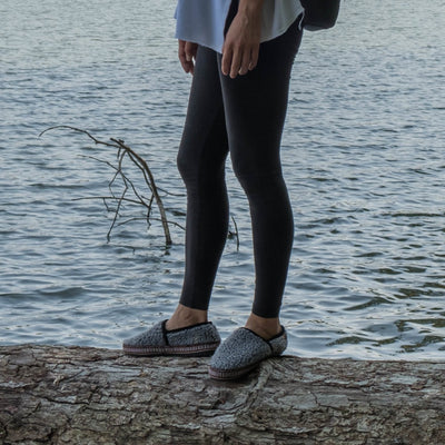 Women's Woven Trim Moccasins on figure standing outside on log by the water