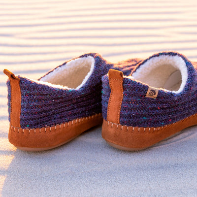 Men's Recycled Camden Moccasins in navy sitting on sandy beach under the sun