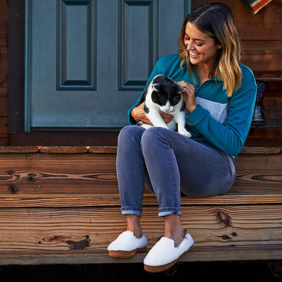 Women's Lightweight Bristol Loafer in Buff Popcorn on model sitting on the stairs of a porch holding a cat