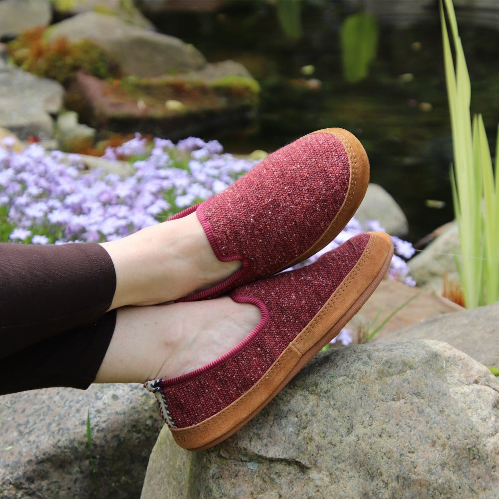 Women's Lightweight Bristol Loafer in Copper on model sitting with their feet up on a rock by a koi pond
