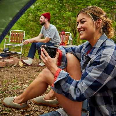 Acorn Bristol Slipper on Female Model sitting at a Campsite with Friends